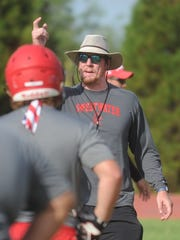 Sweetwater offensive coordinator Blake Spears works with the offensive linemen during the Mustangs' first day of fall practice Monday, Aug. 7, 2017. Spears is a former Cooper and Abilene Christian offensive lineman.
