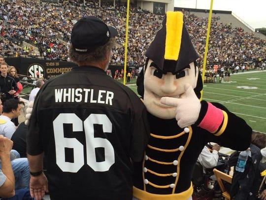 "Vanderbilt fan Preacher Franklin, left, wears his ""Whistler"" jersey alongside mascot Mr. Commodore at a Vanderbilt football game."