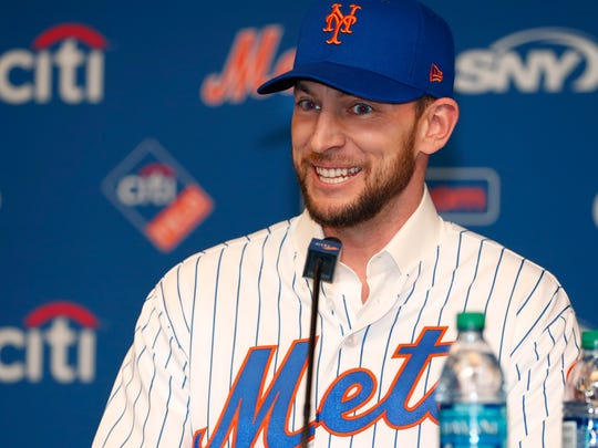 New York Mets All-Star infielder Jed Lowrie smiles as he talks to the media during a press conference introducing him, after he signed with the team, Wednesday, Jan. 16, 2019, in New York. (AP Photo/Kathy Willens)