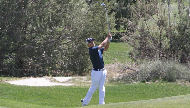 Piedra Vista's Trey Diehl hits his approach shot on No. 10 at Piñon Hills Golf Course on Thursday.
