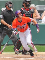 Clemson sophomore first baseman Seth Beer (28) hits a fly ball against Louisville Friday at Doug Kingsmore Stadium in Clemson.