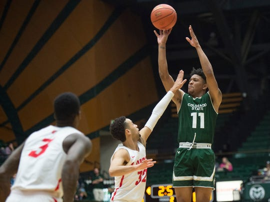 CSU guard Prentiss Nixon jumps high to shoot over New