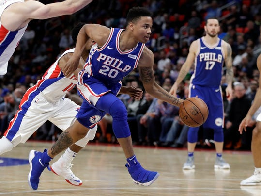 FILE - In this Oct. 23, 2017, file photo, Philadelphia 76ers guard Markelle Fultz (20) drives to the basket during the second half of an NBA basketball game against the Detroit Pistons in Detroit. Fultz will return to the 76ers' lineup on Monday, March 26, 2018. Coach Brett Brown made the surprise announcement before the Sixers' game against Denver. (AP Photo/Carlos Osorio, File)