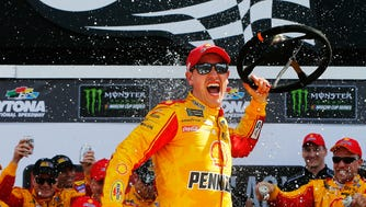 Joey Logano celebrates in victory lane after winning Sunday's Advance Auto Parts Clash.