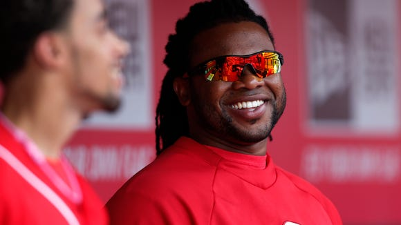 Reds starting pitcher Johnny Cueto (right) talks with center fielder Billy Hamilton on May 11.