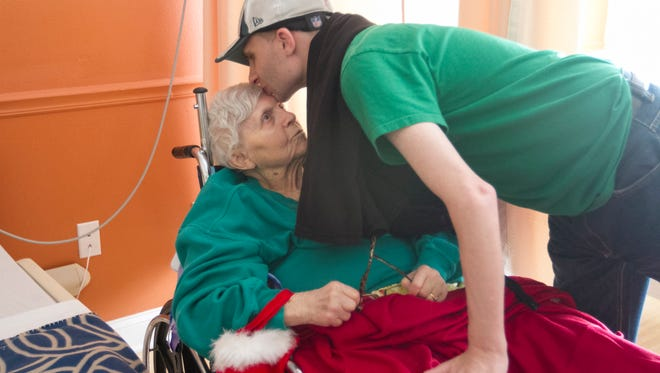 Florence Muchnick gets a goodbye kiss from her grandson Ryan after a visit on Christmas Eve. Muchnick, who has Alzheimer's, lives in a nursing facility in Fort Myers.