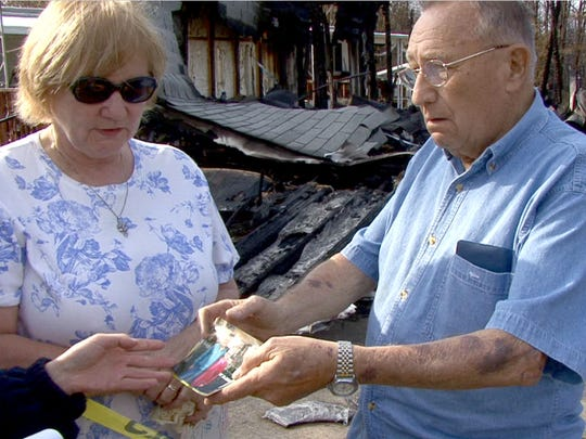 In 2007 Lester Balkie and his daughter Janice Murray display photos of Lester and his recently deceased wife Catherine outside their home at 83 Brighton Road in Barnegat.   The home was destroyed in the 2007 wildfire.