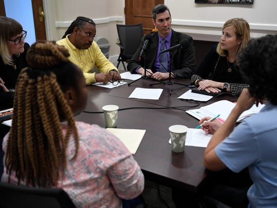 Tennessean opinion editor David Plazas, center, leads