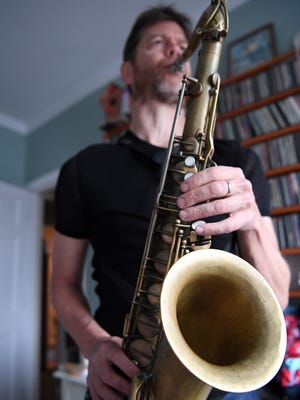 Jazz saxophonist Donny McCaslin poses for a picture at his home in New York City earlier this month. His group will perform in Arden Saturday night.