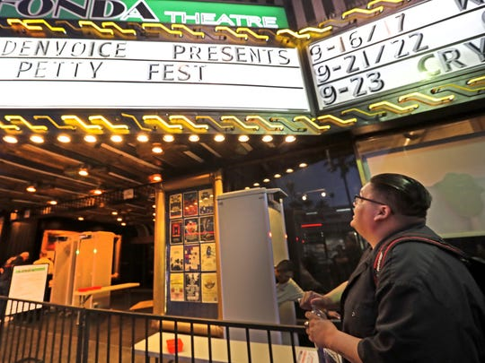 Jon Wheelock reads the marquee before the opening of Petty Fest Sept. 13 at the Fonda Theater in Hollywood, California.