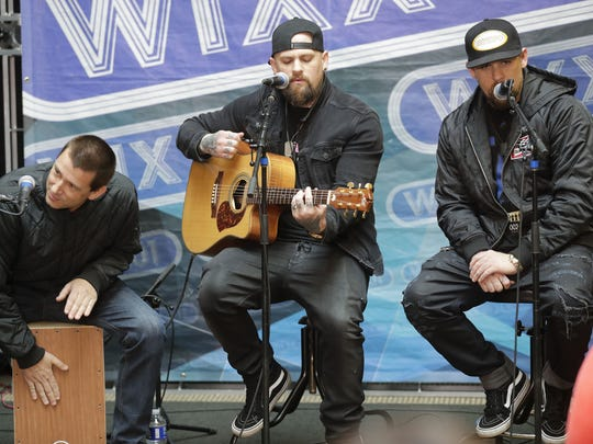 Good Charlotte's Joel Madden, from right, Benji Madden
