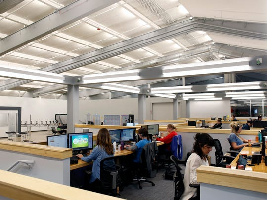 Individual desks and office space sit above the giant working floor space in the former Thunderbird Lanes bowling alley, which has been renovated and turned into the 24G office building.