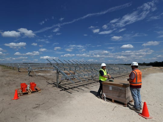 Johan Vanhee, left, the managing director of operations for Orgis Energy and Craig Magnus, project engineer with Blattner Energy, stand at the edge of the framework the companies are constructing for a 20 megawatt, 120-acre solar farm on the border of Tallahassee International Airport.