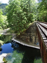 The Salmonberry River offers a swim hole beneath the first railroad bridge.