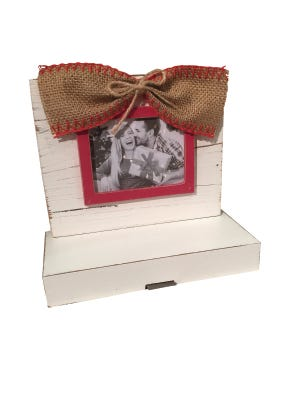 Picture-frame stocking holder, $28.99, Pizzaz.