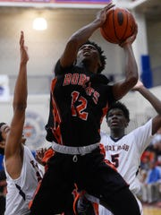 Jeff Reynolds goes up for a layup Wednesday against William Penn.