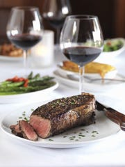 The bone-in New York strip with grilled asparagus from Fleming's. It made Wine Spectator's choice of restaurants with great wine lists.