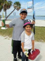 "Winners of previous  ""Ding"" Darling Kids Fishing Derby show off their trophies. This year's contest is Saturday."