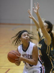 Central York's Teirra Preston eyes the basket during