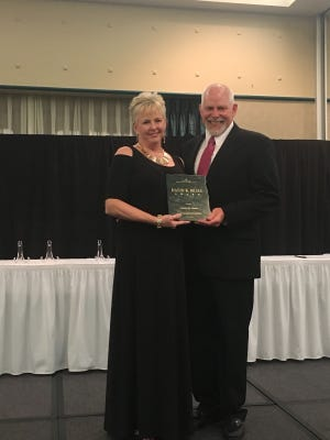 Carolyn M. Mauck, Del Mar College professor of Kinesiology, Health Studies and Recreation, received the David K. Brace Award from Shirl Walter, 2016 President of the Texas Association for Health, Physical Education, Recreation and Dance.