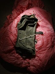 A parachute requested by D.B. Cooper, harvested of some of its cord, then discarded on the plane, is part of the body of evidence gathered in the investigation of his hijacking. Shown at the FBI Seattle office Wednesday, Nov. 14, 2007. Cooper jumped from a flight from Sea-Tac to Reno that he hijacked, but his body was never found. Nov. 27 is the 36th anniversary of the case, the FBI's only unsolved hijacking.  (AP Photo/Post-Intelligencer, Andy Rogers ) **MANDATORY CREDIT, MAGS OUT, NO SALES, SEATTLE TIMES OUT**