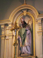 St. Patrick, himself, in his proper spot above the main altar, at St. Patrick's in Adell. SCHRC photo