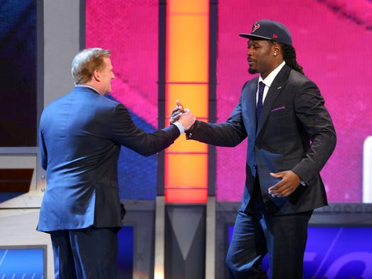 Jadeveon Clowney (South Carolina) shakes hands with Roger Goodell after being selected as the number one overall pick in the first round of the 2014 NFL Draft to the Houston Texans at Radio City Music Hall.