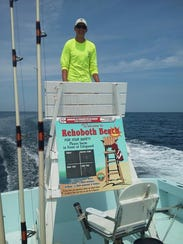Mate Luke Sampson on a recovered lifeguard stand aboard
