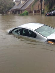 A submerged vehicle on Water Oak Drive.