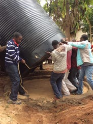 Students from UW-Stevens Point help Kenyans install