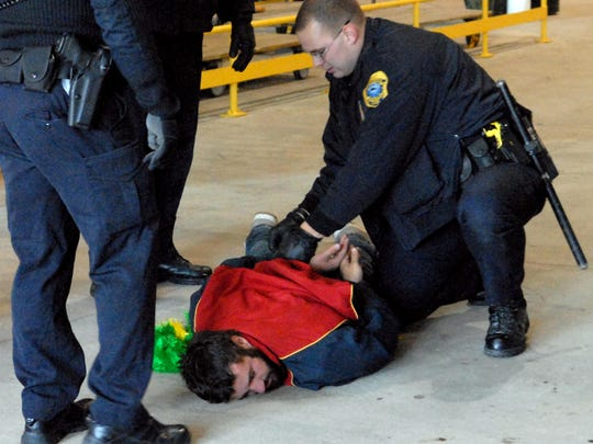 Green Bay police officers arrest a fan after a scuffle on the concourse during a Green Bay Packers game at Lambeau Field against the Minnesota Vikings in November 2007. Home games against the Vikings often result in several game-day arrests and ejections.