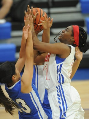 Cooper's Daniece Edwards, left, loses her glasses as San Angelo Lake View's Alaysia Capuchina, left, and another teammate defend in the second half. Cooper beat the Maidens 85-26 in the District 4-5A game Friday, Feb. 2, 2018 at Cougar Gym.
