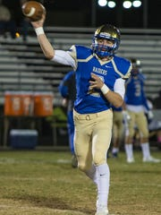 Reed quarterback Cameron Emerson throws a pass against