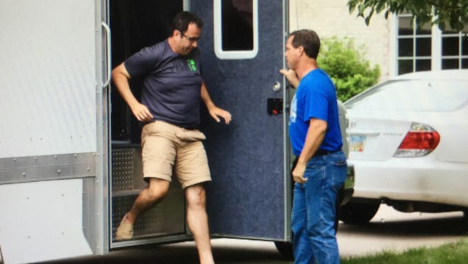 Jared Fogle, left, who rose to fame as the Subway pitchman, steps from a police evidence truck parked in the driveway of his Zionsville, Ind., home on Tuesday, July 7, 2015, the day authorities searched his home. On Wednesday, Aug. 19, 2015, Fogle appeared in federal court in Indianapolis.
