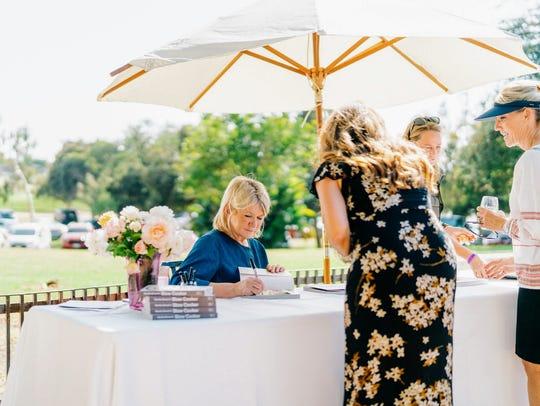 Martha Stewart autographs her newest cookbook during