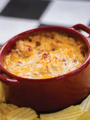 Loaded Potato Chip Dip is packed with bacon and cheese.