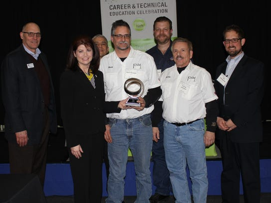 2017 TopTech Award recipient KNM, Manitowoc. Left to
