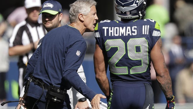 Seattle Seahawks coach Pete Carroll talks with free safety Earl Thomas during a 2018 game against the Dallas Cowboys in Seattle. Two years later, Thomas, who was just released by the Baltimore Ravens, is looking for a team to sign him.