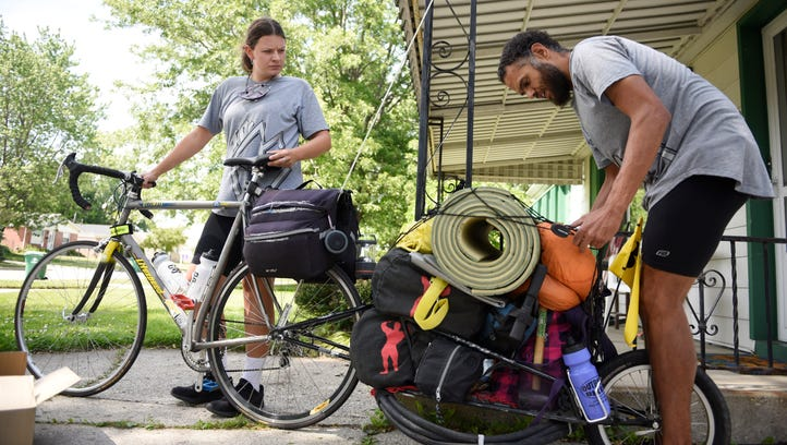 Brian Mitchell, 37, packs his trailer with food and