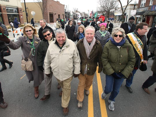 Republican politicians march down South Street during