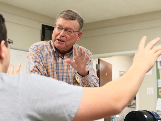Robert Fries, professor of astronomy at Anderson University, talks with sophomore student Carter Dickson earlier this year about movement of the sun during his class.