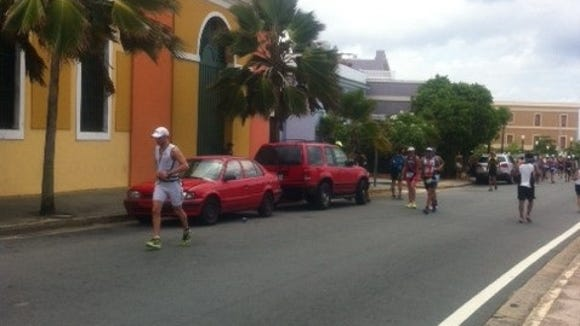Runners compete in an Ironman triathlon on April 13 in San Juan, Puerto Rico.