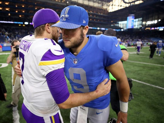 Lions quarterback Matthew Stafford greets Vikings quarterback Case Keenum after the Vikings defeated the Lions, 30-23, at Ford Field on Thursday, Nov. 23, 2017.