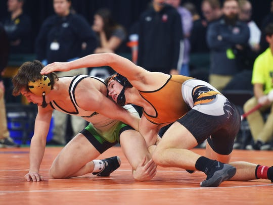 Pierre's Cade Hinkle wrestles Lennox's Tyson Stoebner at last year's state meet.