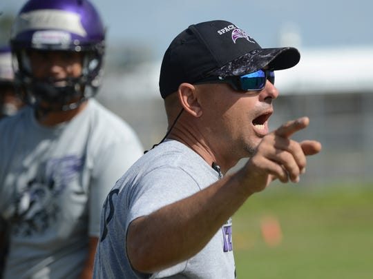 New Space Coast football coach Matt Diesel directs