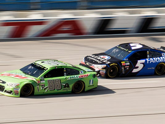 Dale Earnhardt Jr. (88) drives in front of Kasey Kahne, during practice for the NASCAR Cup Series auto race Friday, Oct. 13, 2017, at Talladega Superspeedway in Talladega, Ala. (Bob Crisp/The Daily Home via AP)