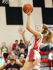 Incarnate Word's Sydney Allison takes lays the ball in against West Oso during the Roy Williams Holiday Tournament on Wednesday, Dec. 28, 2016, at West Oso High School in Corpus Christi.