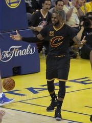 Cleveland Cavaliers forward LeBron James (23) reacts during the first half of Game 2 of basketball's NBA Finals against the Golden State Warriors in Oakland, Calif., Sunday, June 4, 2017. (AP Photo/Marcio Jose Sanchez)