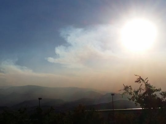 """""""Setting sun viewed through smoke as it is starting to blow into Reno from the west on Wednesday evening."""" The smoke is from the King Fire in California on Wednesday, Sept. 17, 2014. Submitted by Terry Dee of Reno."""