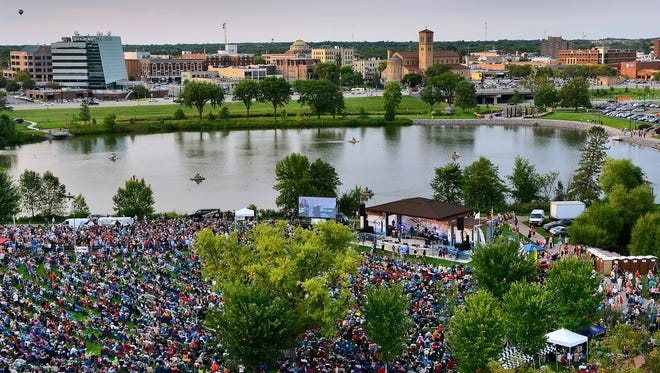 The crowd packs in to listen to the music of the Fabulous Armadillos Wednesday night during the final week of Summertime by George! for the season.